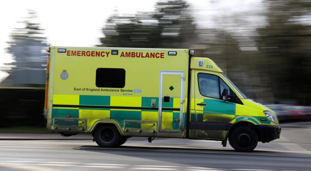 Ambulance workers were unable to save a man who fell through a roof