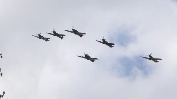 Spitfires and Hurricanes flying in formation