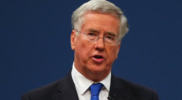 Defence Secretary Michael Fallon has warned that Russia's military build-up in Syria is complicating efforts to resolve the civil war