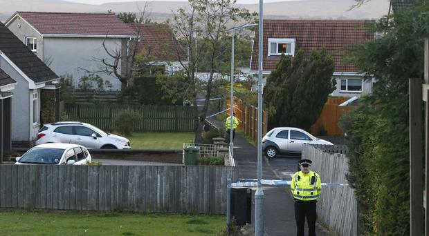 Police near the scene in Bishopbriggs, East Dunbartonshire, where a man was shot close to a primary school