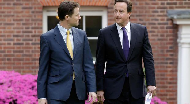 David Cameron and Nick Clegg hold their first joint coalition government press conference in the Downing Street garden