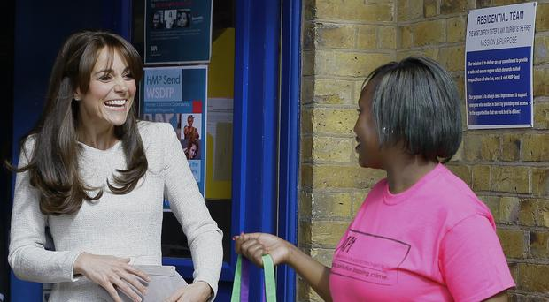 The Duchess of Cambridge speaks to Isha Walker, who is taking part in a programme run by the Rehabilitation of Addicted Prisoners Trust, during a visit to HMP Send in Surrey