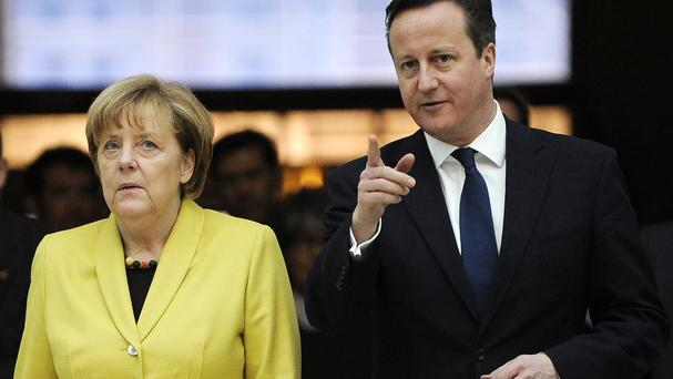 Prime Minister David Cameron is facing claims he delayed the imposition of new vehicle emission limits at the request of German Chancellor Angela Merkel