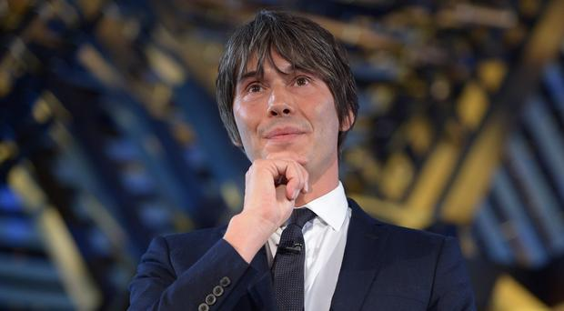 Professor Brian Cox has condemned a decision to bar human rights campaigner Maryam Namazie from speaking at the University of Warwick