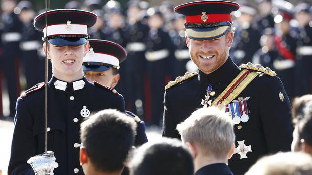 Prince Harry inspects the student guards during his visit to the Duke of York's Royal Military School in Dover