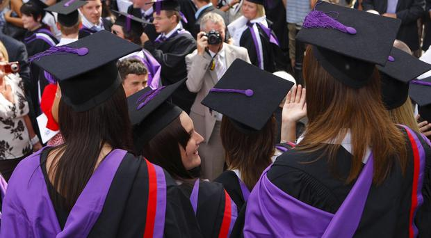The earnings gap between graduates and non-graduates in professional positions is closing, research claims