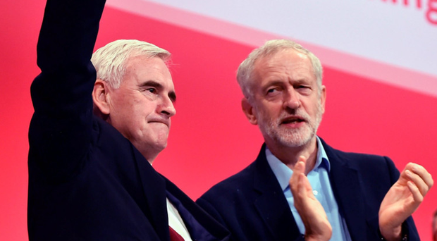 Shadow chancellor John McDonnell and Jeremy Corbyn take applause after addressing the Labour Party autumn conference in Brighton yesterday