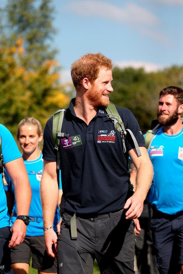 Prince Harry with armed forces veterans on the Walking With The Wounded 1,000-mile trek across Britain yesterday