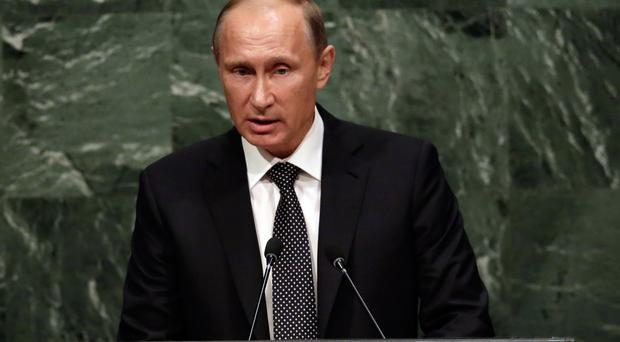 Vladimir Putin said Russia had attacked and destroyed eight IS positions in Syria (AP)