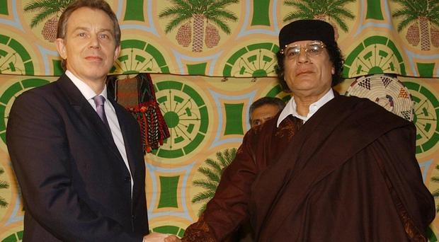 Tony Blair privately urged Colonel Gaddafi to stand down and find