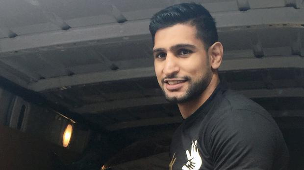 Amir Khan spent an emotional weekend delivering aid to refugees trapped on the Greek island of Lesbos