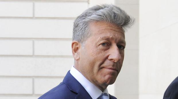 Neil Fox, who denies wrongdoing, arrives at Westminster Magistrates' Court