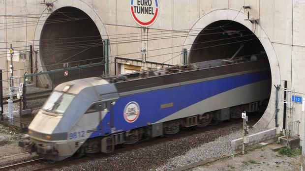 Eurotunnel said a large group of migrants stormed the Channel Tunnel
