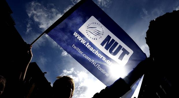 Low morale, workload and pay are key problems for teachers, says the NUT