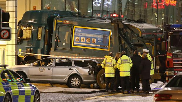 The scene in Glasgow's George Square after a bin lorry crashed in the city centre and killed six people.
