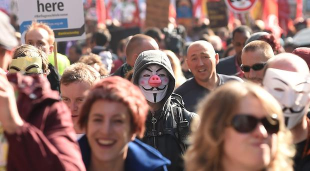 Activists during an anti-austerity march ahead of the start of the Conservative Party Conference in Manchester. (PA)