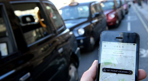 Transport for London and Uber are seeking clarification as to whether smartphones can lawfully be used to calculate fares