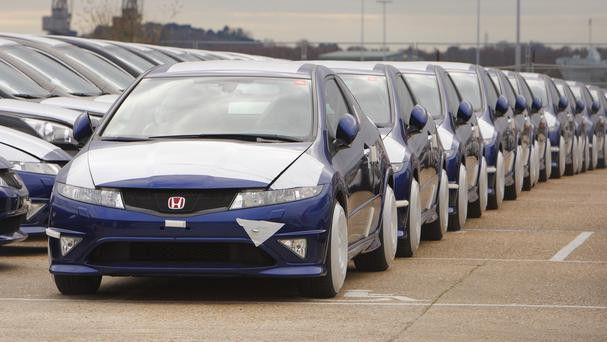 New Honda cars lined up at Southampton docks as figures reveal that more than two million new cars have been sold since the start of the year, the best performance in over a decade
