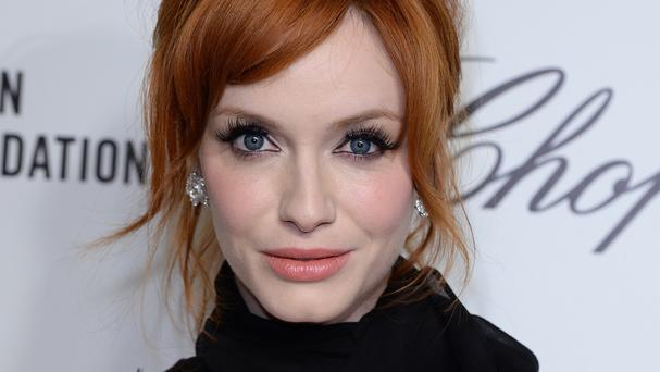 Actress Christina Hendricks, known for her vibrant red locks, starred in the Clairol Nice 'N Easy hair dye advert