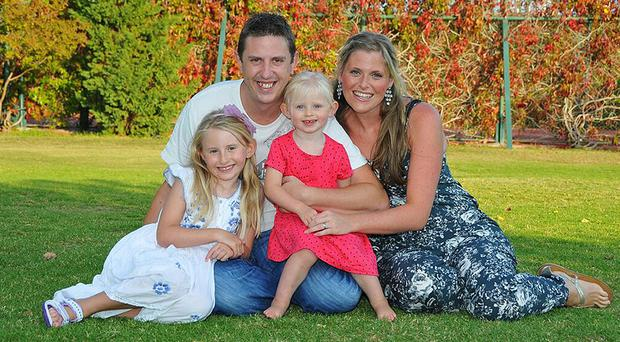 Pc David Phillips, 34, was married to Jen and had two daughters - Abigail, seven, and Sophie, three (Merseyside Police/PA)