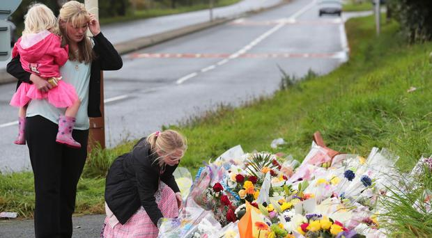 Pc David Phillips's wife Jen and daughters Abigail and Sophie visit the scene in Wallasey where the Merseyside officer was mown down and killed by a stolen car