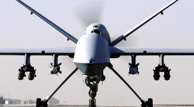 An RAF drone killed two Britons in an attack near the Syrian city of Raqqa