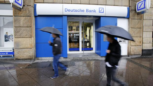 Germany's largest bank said it would book charges of 5.8 million euro (£4.3 billion) on the value of businesses it had previously bought
