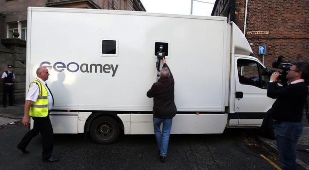 A van believed to be carrying Clayton Williams arriving at Wirral Magistrates' Court