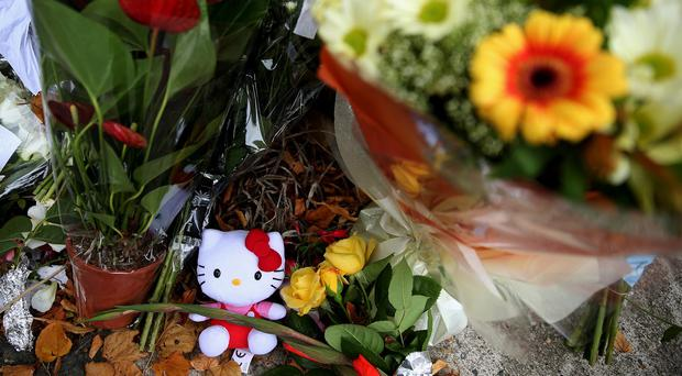 Toys and flowers are left at a halting site for travellers in Carrickmines, south Dublin.