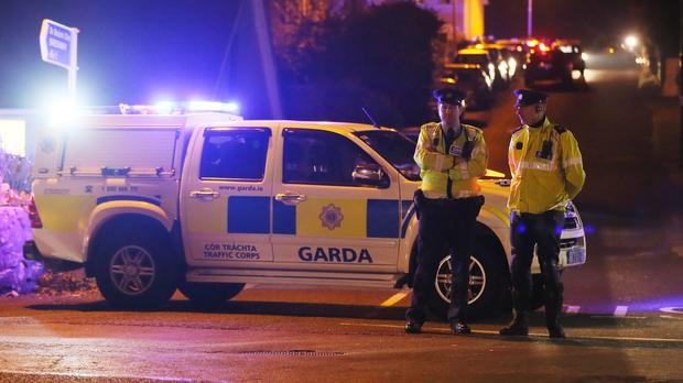 Police close off a road in Omeath, Co Louth, after two men, one of them a garda, died