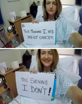 Brave BBC journalist Victoria Derbyshire holds up cards from her hospital bed in an image from the video diary she has made to help other women facing breast cancer