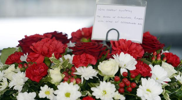 A floral tribute at the funeral of Flight MH17 victim Liam Sweeney.