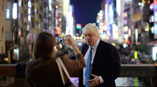 Boris Johnson poses for a photograph in Osaka, Japan