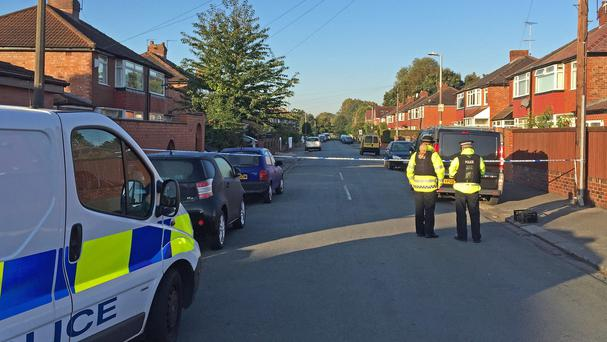 Police at Gillingham Street, Salford, where a mother and son were wounded by a gunman