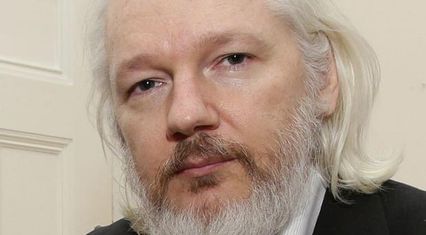 WikiLeaks founder Julian Assange is suffering from shoulder pain