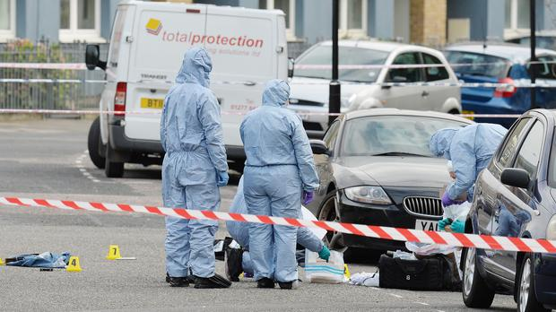 Forensic officers search the area in Hackney, east London