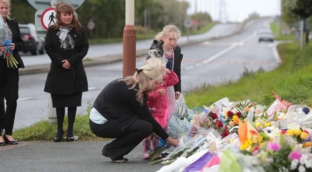 The family of Pc David Phillips lay flowers at the scene where the Merseyside officer was mown down and killed by a stolen car
