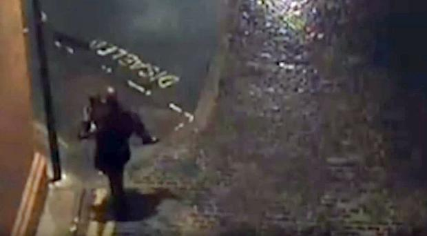 CCTV still showing a man carrying a 24-year-old woman before she was raped in Leeds (West Yorkshire Police/PA)