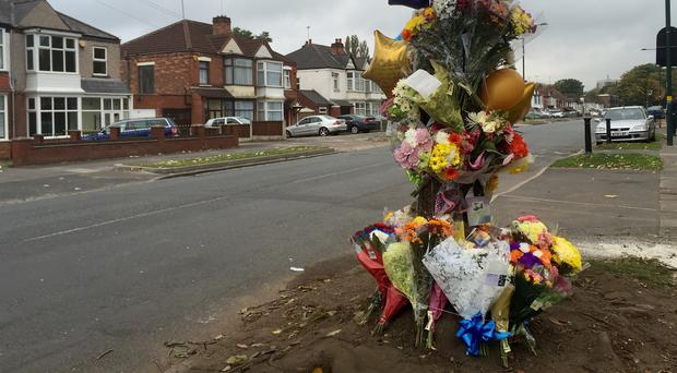 Flowers laid at the scene where Kane Balogun, 14, died when the car he was in struck a tree on Stechford Road, Hodge Hill, Birmingham.