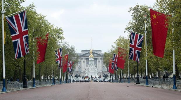 Chinese flags along The Mall in London, as preparations begin for the Chinese state visit which begins on Tuesday