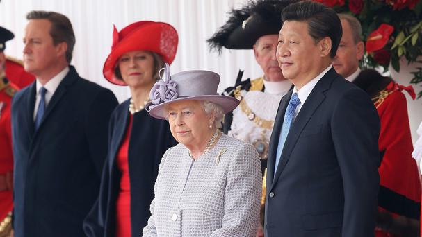 From left, Prime Minister David Cameron, Home Secretary Theresa May, the Queen and Chinese president Xi Jinping on the first day of his state visit to the UK