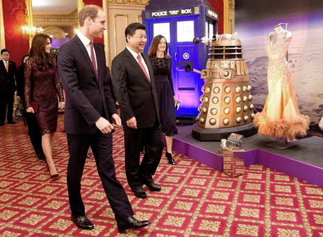 Prince William and Xi Jinping walk past a Doctor Who display, including a dalek and Tardis