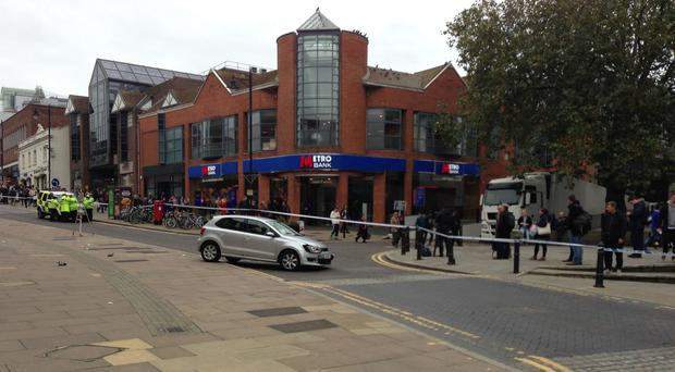 The scene in Guildford, Surrey, after a car mounted the pavement next to the entrance of a shopping centre, injuring pedestrians