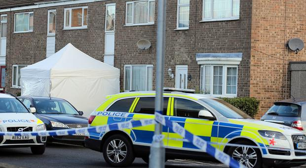 Police at the scene in Duck Lane, St Neots, Cambridgeshire, after Richard Davies was shot dead by police following a stand-off