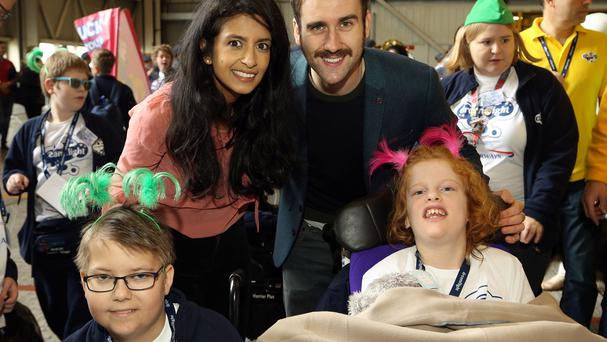 Konnie Huq and Matthew Lewis with some of the children en route to Florida with the Dreamflight charity