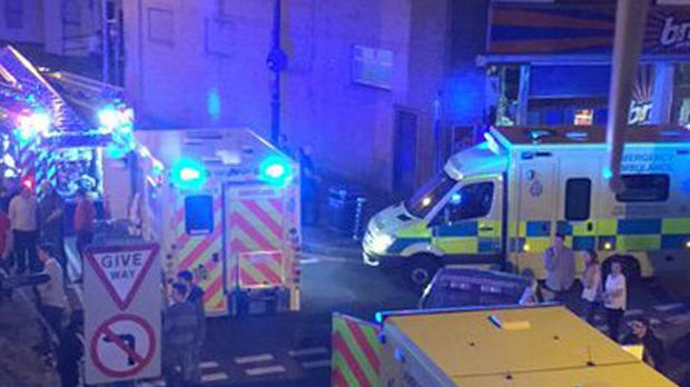 Emergency services at the scene in Porthcawl of a car crash outside a nightclub is which 13 people were injured (@lalalauren1990/Twitter/PA)