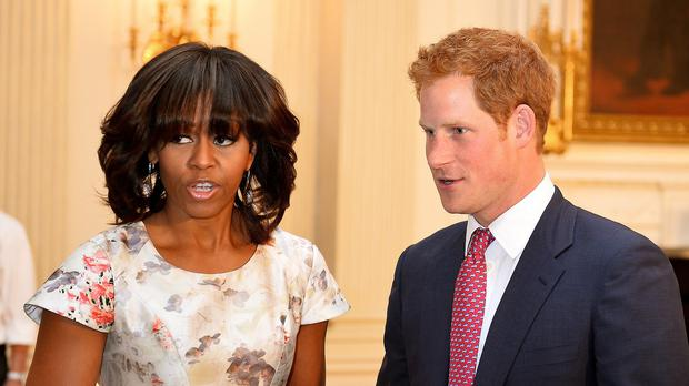 Prince Harry with First Lady Michelle Obama at the White House, as the pair will meet wounded servicemen and women undergoing rehab when they visit a US military base.
