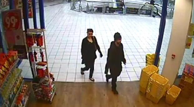Nathan Matthews and Shauna Hoare caught on CCTV in the 99p store in Bedminster on February 22 (Avon & Somerset Police/PA)