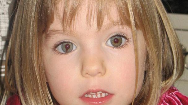 Scotland Yard's investigation into the disappearance of Madeleine McCann has been cut from 29 officers to four