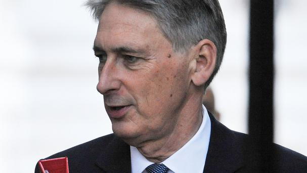 Foreign Secretary Philip Hammond said previous multiculturalism policies had been 'too tolerant of intolerance'